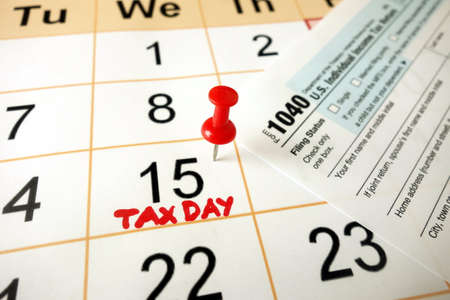 Monthly calendar showing date July 15th 2020 marked as tax day with 1040 form