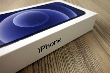 KONSKIE, POLAND - November 22, 2020: Box with new iphone 12 smartphone inside 新闻类图片