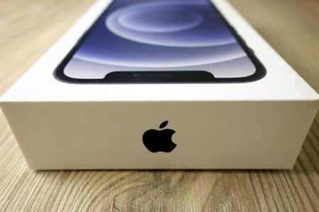 KONSKIE, POLAND - November 22, 2020: Box with Apple company logo and new iPhone 12 smartphone inside 新闻类图片