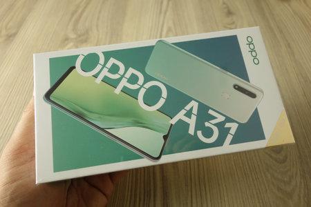 KONSKIE, POLAND - November 16, 2020: Box with new Oppo A31 smartphone inside