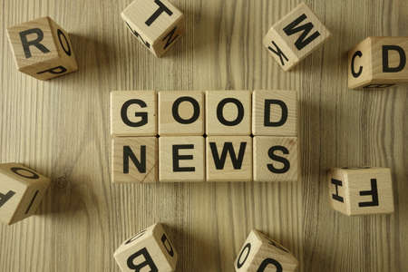 Text good news from wooden blocks, positive information concept