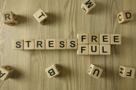Word stress-free or stressful from wooden blocks, lifestyle concept