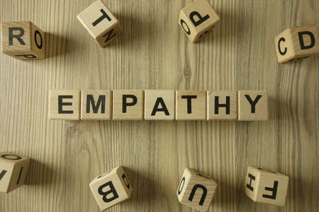 Word empathy from wooden blocks, kindness and compassion concept
