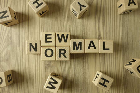 Text new normal from wooden blocks, business change concept