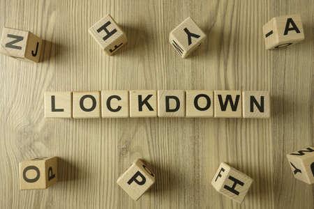 Word lockdown from wooden blocks, coronavirus pandemic concept