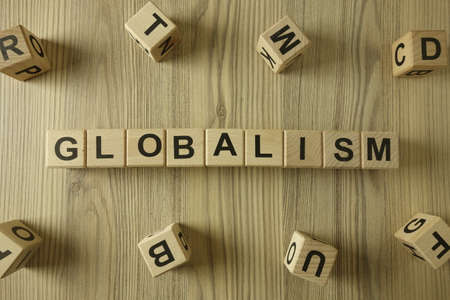 Word globalism from wooden blocks, globalization concept