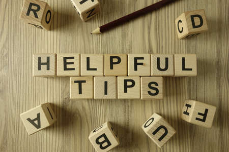 Text helpful tips from wooden blocks, advice or information concept