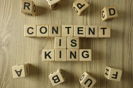 Text content is king from wooden blocks, seo search engine optimization concept