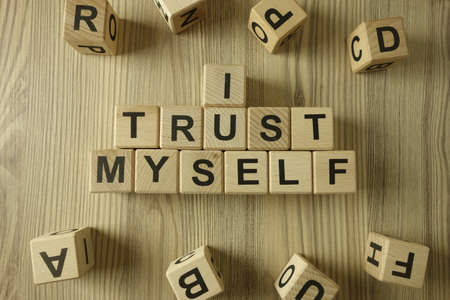 Text I trust myself from wooden blocks, self confidence concept