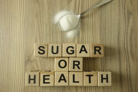 Text sugar or health from wooden blocks, healthy nutrition concept