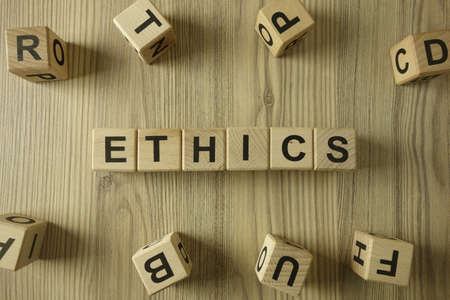 Word ethics from wooden blocks, moral responsibility concept 免版税图像