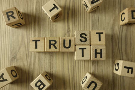 Word trust or truth from wooden blocks, business partnership and reliability concept