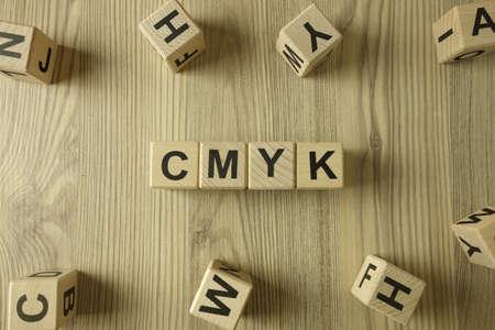 Word cmyk from wooden blocks on desk 免版税图像