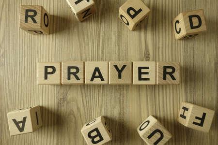 Word prayer from wooden blocks, religion and spirituality concept 免版税图像