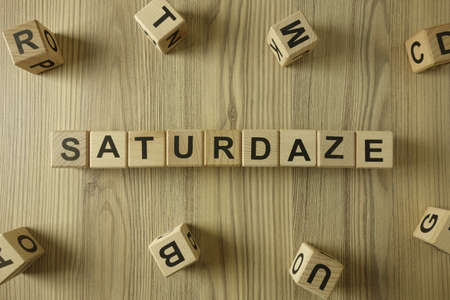 Word saturdaze from wooden blocks, hard partying, tiredness and nausea