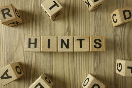 Word hints from wooden blocks, information help concept