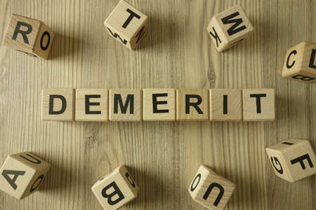 Word demerit from wooden blocks, business disadvantage or offense concept