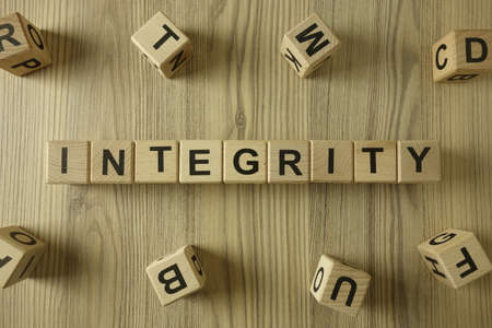 Word integrity from wooden blocks, sincerity and ethics concept