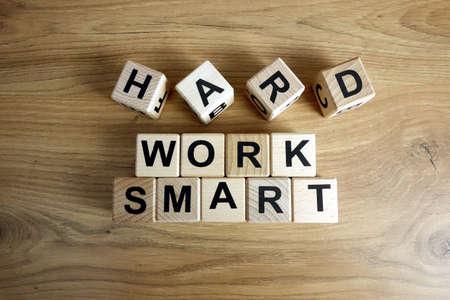 Text work smart from wooden blocks, business development success and creativity concept 免版税图像