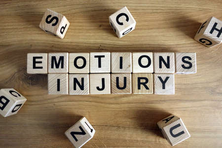 Text emotions injury from wooden blocks on desk