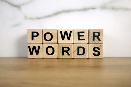 Text power words from wooden blocks, communication and motivation concept 免版税图像