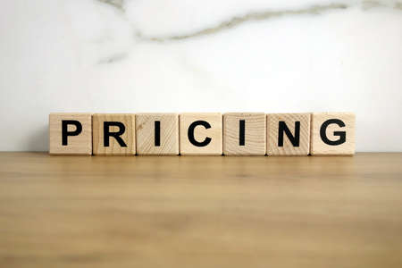 Pricing word from wooden blocks, business strategy concept