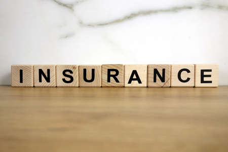 Insurance word from wooden blocks, financial concept