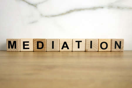 Mediation word from wooden blocks, communication process concept