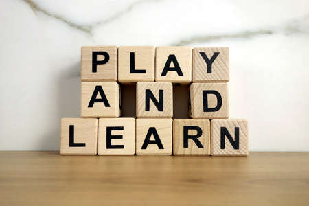Play and learn text from wooden blocks, education concept