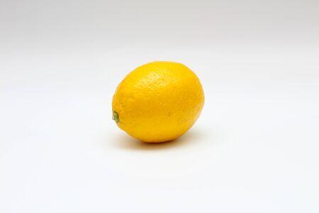 juicy single lemon on a white background. Studio macro shoot