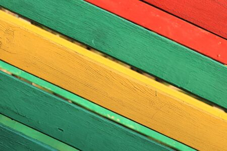 The surface of the nailed boards painted in green, yellow and red. Background picture