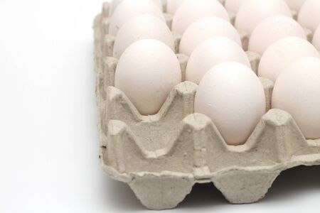 Isolated recycle tray with white eggs on a white background. Tray without one egg
