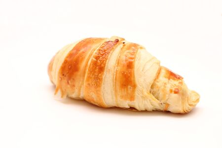 isolated lone french croissant on white background 写真素材