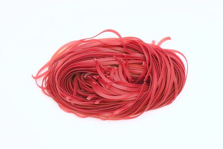 Isolated red spaghetti nest on a white background