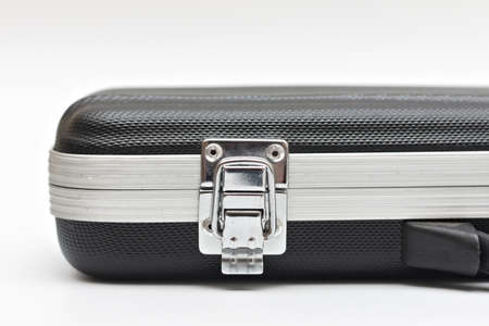 A lock on a small black suitcase. Studio photo on white background 写真素材