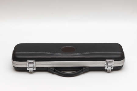 Small long black suitcase for flute on a white background 写真素材