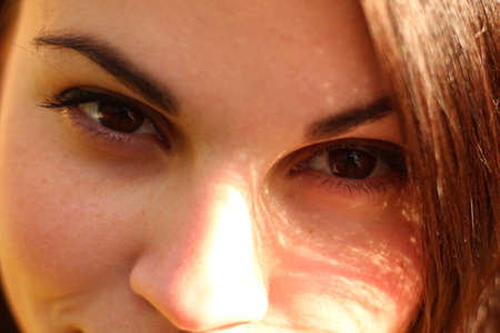 Beautiful female brown eyes close up photo