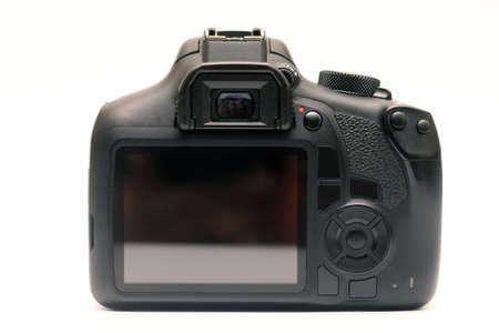 Digital SLR crop sensor body without logos. Back view camera with viewfinder, screen and buttons Foto de archivo