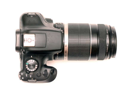 digital SLR camera with large telephoto lens. Top view, studio shooting