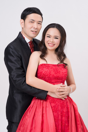 evening gown: Asian couple wearing evening gown and dress. Happy couple expression. Couple dance.