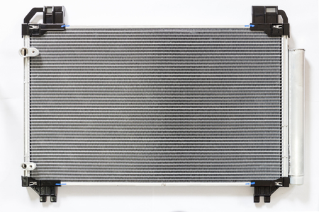 Car condenser radiator on white background. Radiator top view of radiator for pick-up truck radiator set.