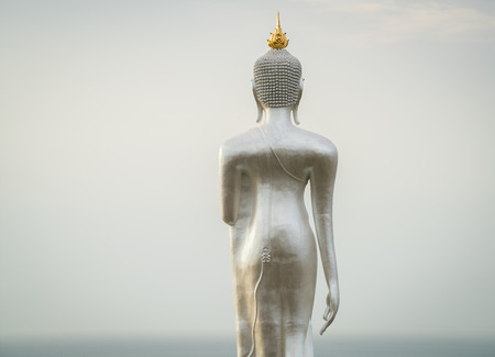 Great buddha statue above the city of Sriracha, Cholburi, Thailand.