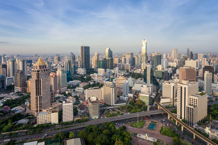 lumpini: Bangkok Thailand city skyline at central business district of Sathorn street daylight in the morning. Drone aerial view. Public park Lumpini in the front.
