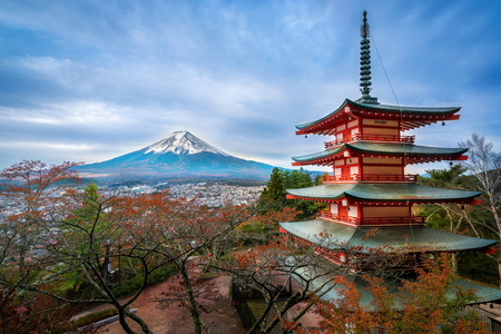 sengen: Mount Fuji and Chureito Pagoda at sunrise in autumn. Chureito pagoda is located in Fujiyoshida, Japan. Mount Fuji, Fuji san is famous natural landmark in Japan. Fuji is Japans highest mountain. Editorial