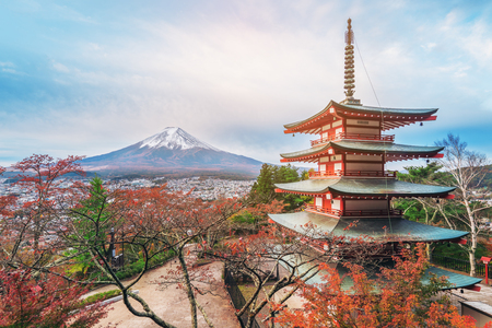 Vintage tone image of Mount Fuji and Chureito Pagoda at sunrise in autumn. Chureito pagoda is located in Fujiyoshida, Japan. Mount Fuji, Fuji san is famous natural landmark in Japan. Editorial