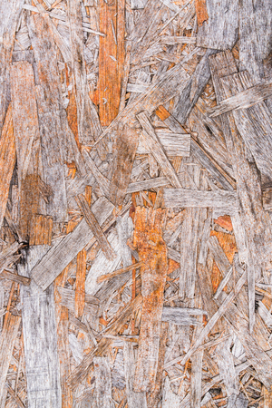 Recycled compressed wood chippings board background. Texture of recycled wooden material background.