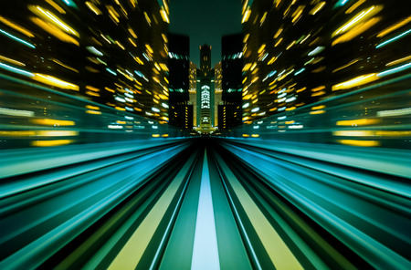 futuristic city: Motion blur train moving in city rail tunnel. Motion blur background abstract.