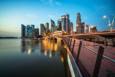 Singapore skyline at night. Singapore central business district skyline, blue sky and night skyline from marina bay. Singapore cityscape. Marina bay, tourist destination and city center of Singapore. 스톡 콘텐츠