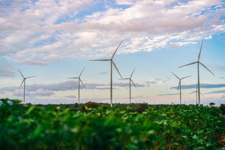 warming up: Wind turbine farm - Environment friendly energy. Sustainability development. Concept of renewable, sustainable and alternative energy from wind power. Stock Photo