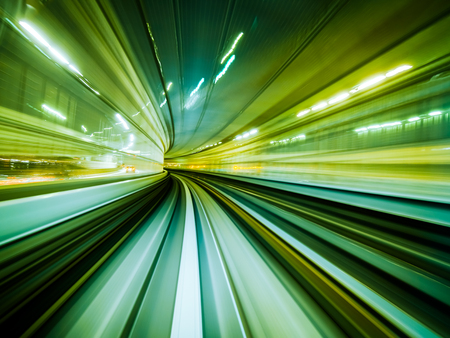 Motion blur train moving in city rail tunnel. Motion blur background abstract.